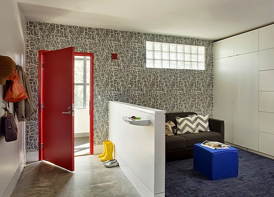 Our entryway: a bold red door flanked by incredible wallpaper by Tres Tintas. Photo credit: Eric Roth.